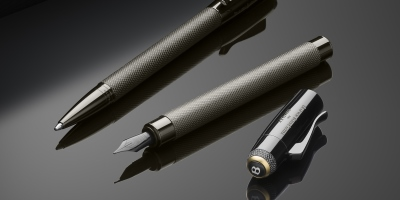 Gold details on Centenary cars reflected in three exclusive pens